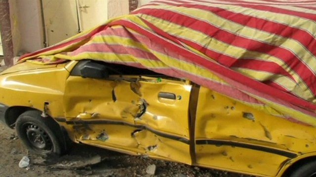 Car damaged in Baghdad explosion