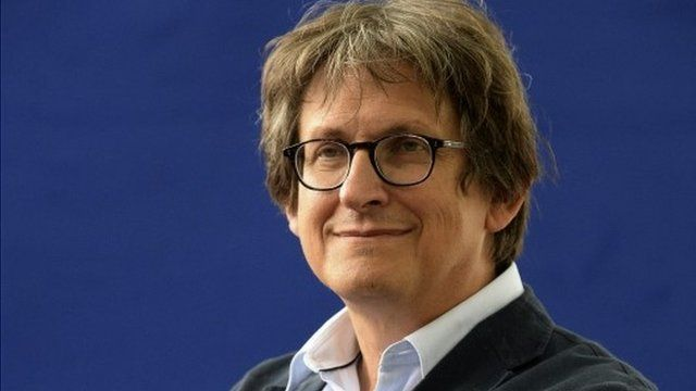 Guardian editor Alan Rusbridger poses for a photograph at the Edinburgh International Book Festival in Edinburgh, Scotland, Thursday, Aug. 22, 2013