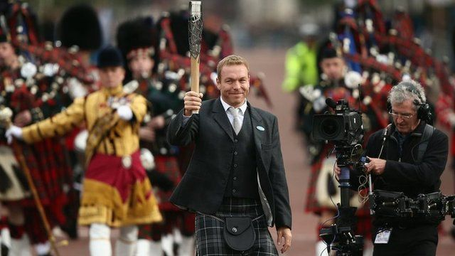 Sir Chris Hoy, Britain's most successful Olympian, carries the Queen's baton on the start of its journey around the Commonwealth countries ahead of the Glasgow 2014 Commonwealth Games.