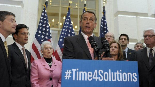 John Boehner surrounded by fellow House Republicans