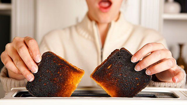 Taking burnt toast out of a toaster