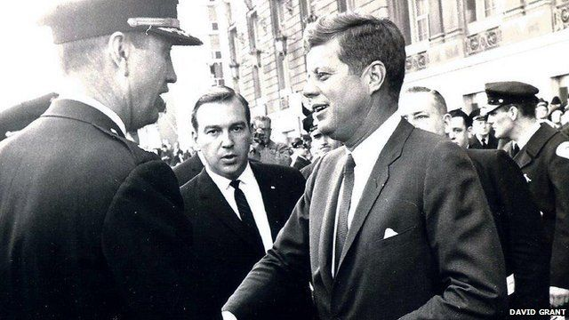 John F Kennedy with agent David Grant to rear