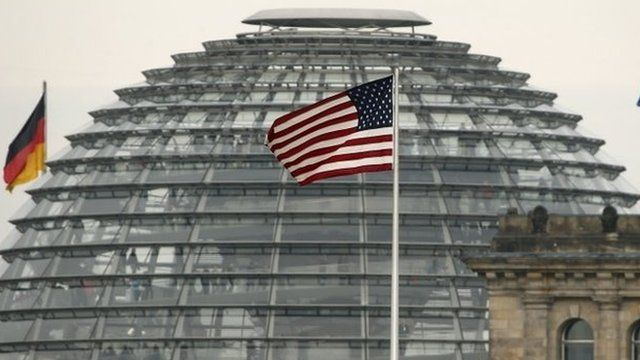 US flag flying over embassy next to German Parliament