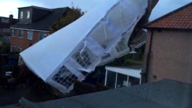 A marquee blown about by the storm in Harrow, Greater London