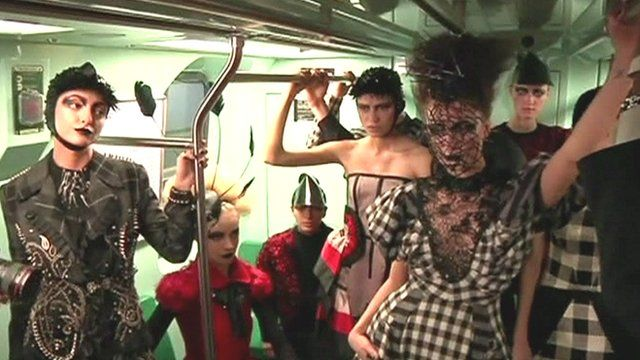 Models standing in a subway carriage