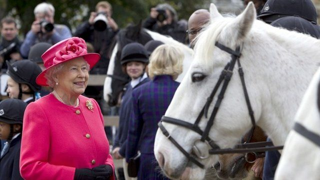 Queen Elizabeth II and Camilla, Duchess of Cornwall during a visit to Ebony Horse Club Community Riding Centre