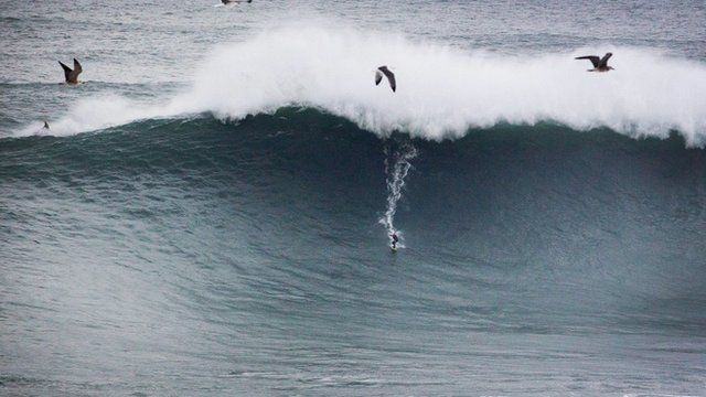 Andrew Cotton surfing