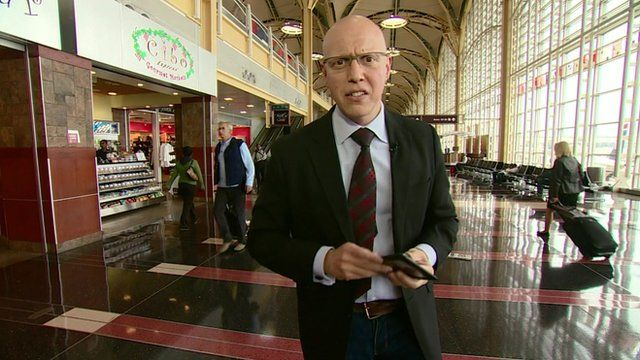 The BBC's Jonny Dymond uses an e-reader at Washington National Airport