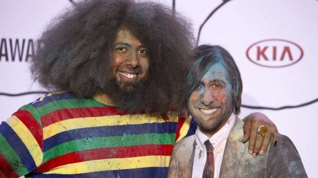 Reggie Watts and Jason Schwartzman pose for a photo after hosting the YouTube Music Awards in New York November 3, 2013