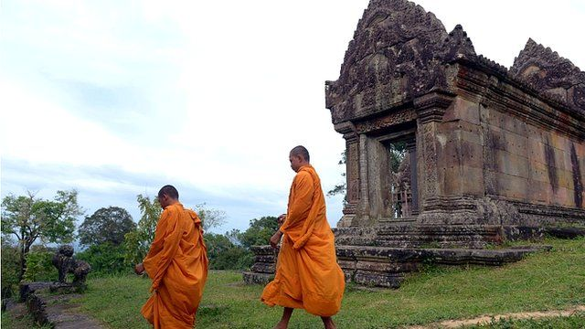 Cambodian Buddhist monks walk at Preah Vihear temple near the Cambodia-Thailand border