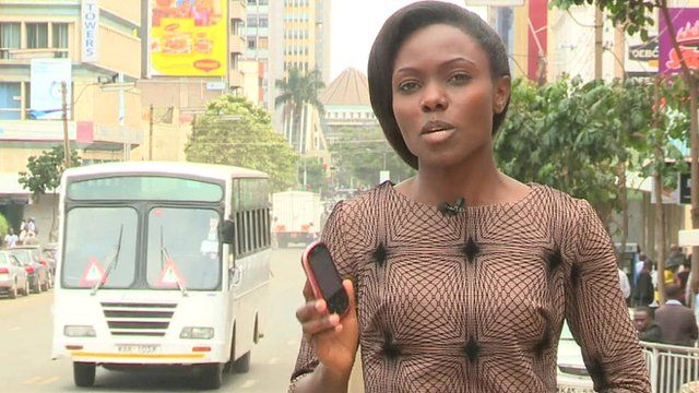 Anne Soy in Nairobi holding mobile phone