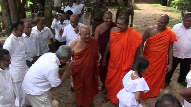 Buddhist monks with officials