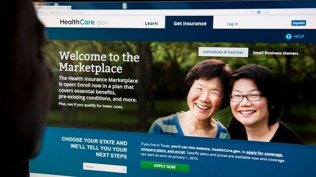 A woman looks at the HealthCare.gov website