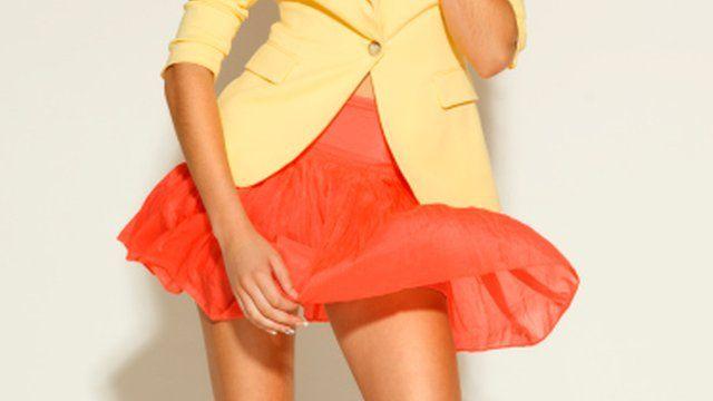 A woman wearing a miniskirt