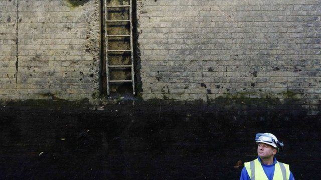 Workman at bottom of Camden Lock