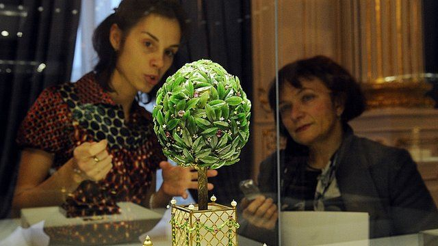 Visitors to Russia's first Faberge Museum observe one item from its vast collection