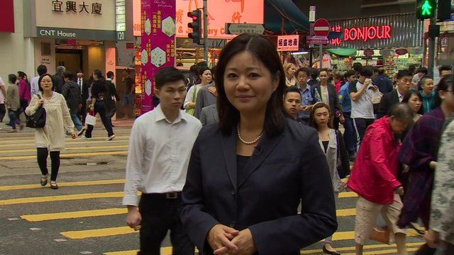 Linda Yueh in busy street