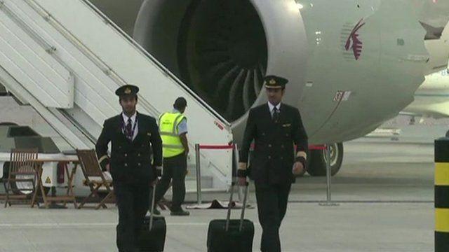 pilots outside plane