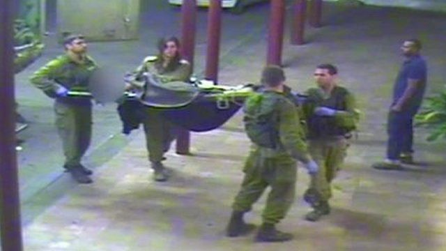 CCTV frame showing Israeli soldiers carrying Syrian casualty into hospital