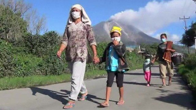 Indonesians walking away from the Mount Sinabung volcano in North Sumatra