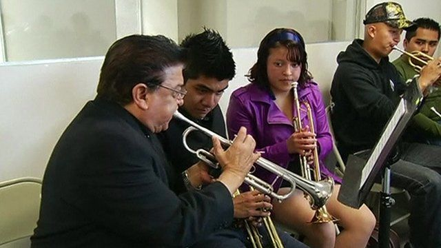 Veteran mariachi Fernando Torres teaches youngsters in the newly inaugurated school in Mexico City