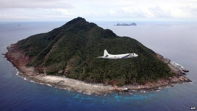 Japanese P-3C patrol plane flies over the disputed islets known as the Senkaku islands in Japan and Diaoyu islands in China, in the East China Sea on 13 October 2011