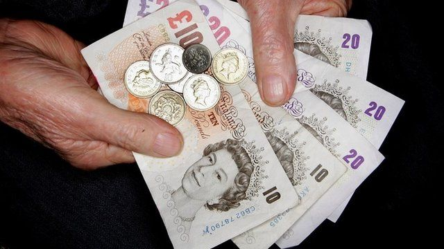 A pensioner holding money