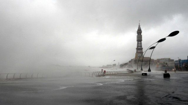 The tide comes over the sea wall in Blackpool, north west England, on December 5, 2013