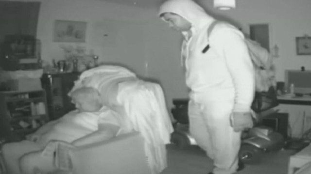 CCTV of Margaret Woodward sleeping while burglar checks on her