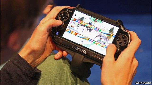 Man playing a PS Vita