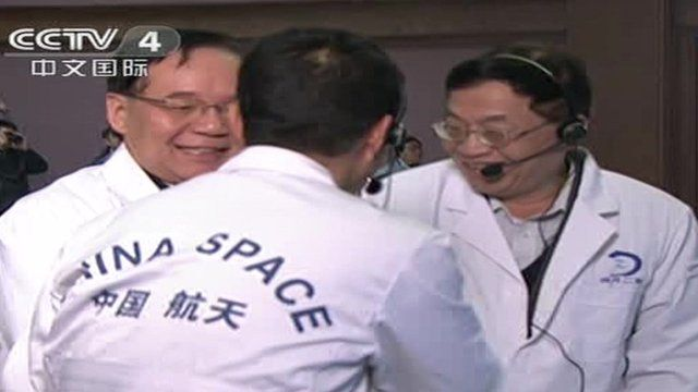 China's space mission team celebrate after the landing