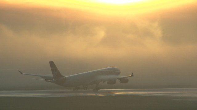 Plane lands on runway