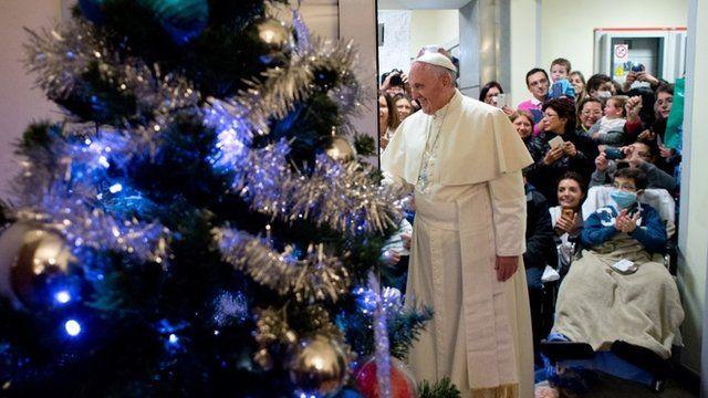 Pope Francis next to Christmas tree