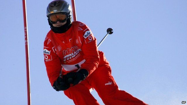 Jan. 13, 2006 file photo, Ferrari driver Michael Schumacher of Germany speeds down a course in Madonna di Campiglio, Italy.