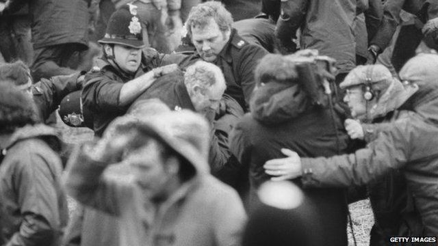 A camera crew films a scuffle between police and miners at a demonstration at Orgreave Colliery, South Yorkshire, during the miner's strike, 1984