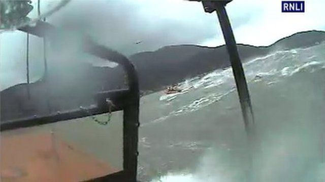 The lifeboats were launched in stormy weather on Friday morning