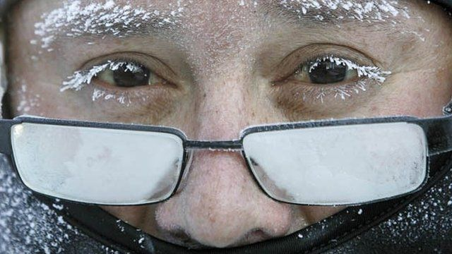 A man on his way to work feels the effects of the icy cold weather in Janesville, Wisconsin