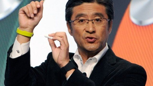 Kunimasa Suzuki displays a Sony SmartBand and Core