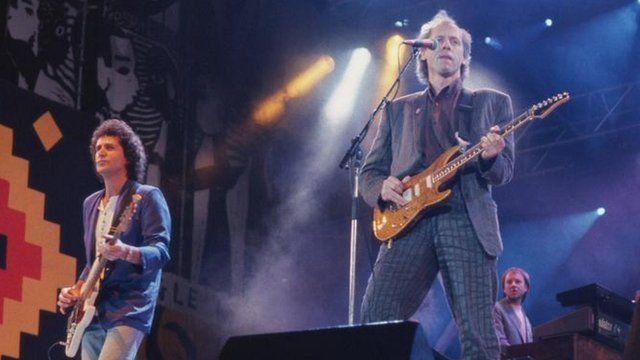 John Illsley (left) performing with Dire Straits