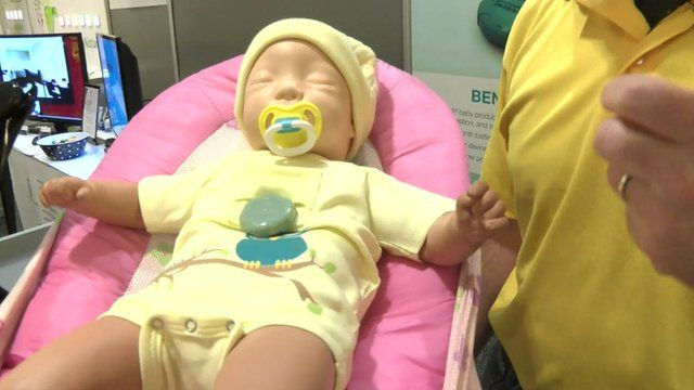 A sensor placed into a specially-made onesie monitors heart rate and temperature