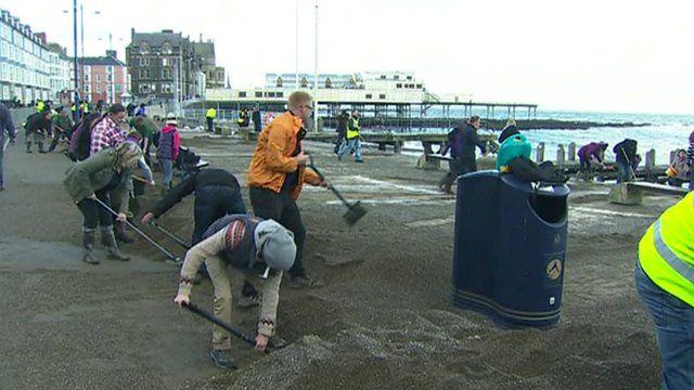 Volunteers help to clean up Aberystwyth promenade