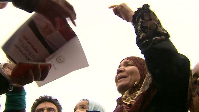 Woman pointing at the referendum document