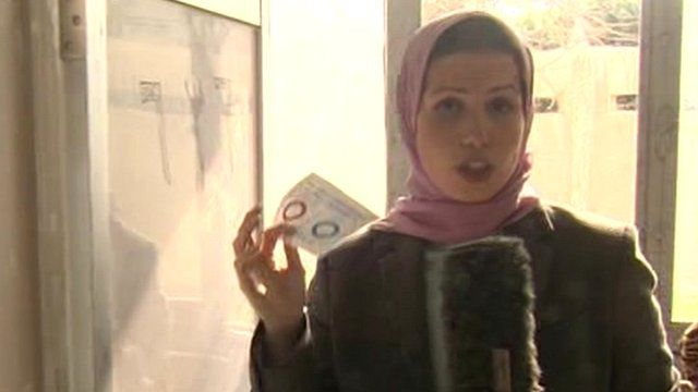 Sally Nabil with a voting paper in an Alexandria polling station
