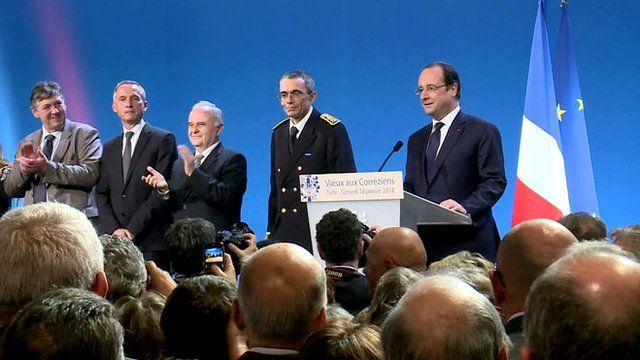 President Hollande (far right) in Tulle