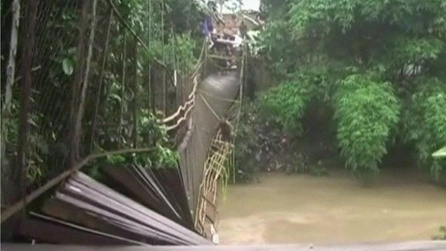 Collapsed bridge hanging above the river in Indonesia