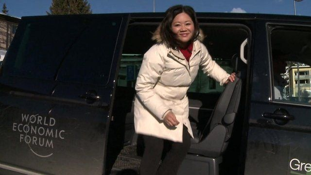 Linda Yueh and shuttle bus in Davos
