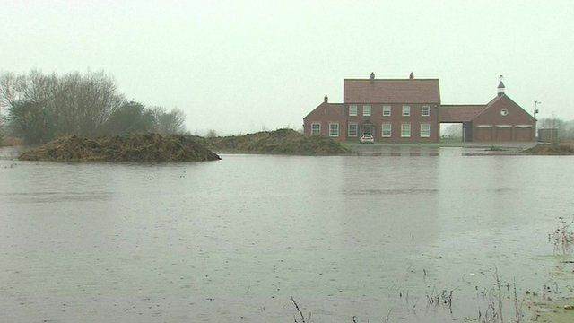 A building surrounded by flooding