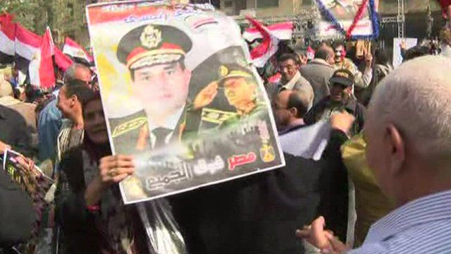 Supporters of the military and government waving posters of General Sisi in Tahrir Square