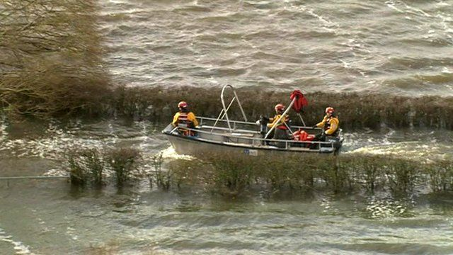 Boat on patrol in flooded Somerset