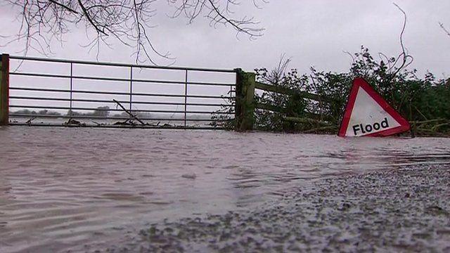 Road showing flood sign